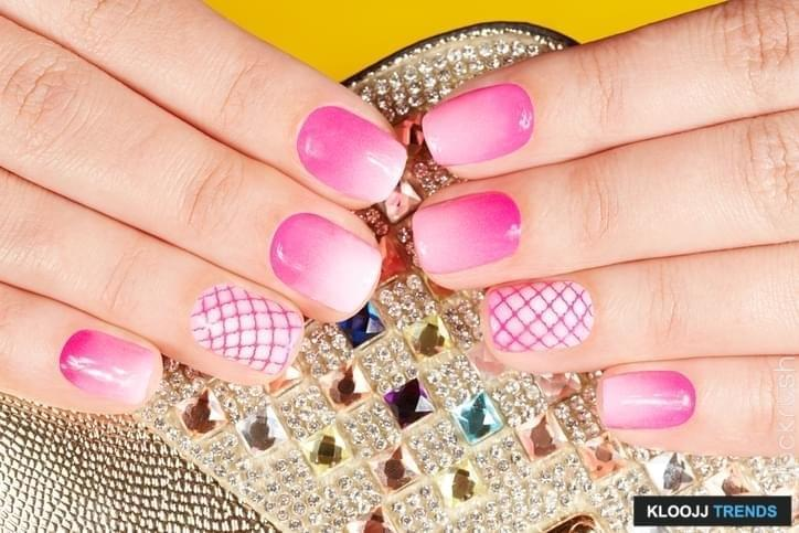 Nails with manicure covered with pink nail polish