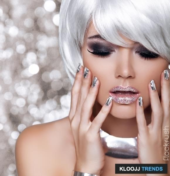 Fashion Blond Girl. Beauty Portrait Woman. White Short Hair. Isolated on blinking Christmas Background. Face Close-up. Manicured nails. Vogue Style.