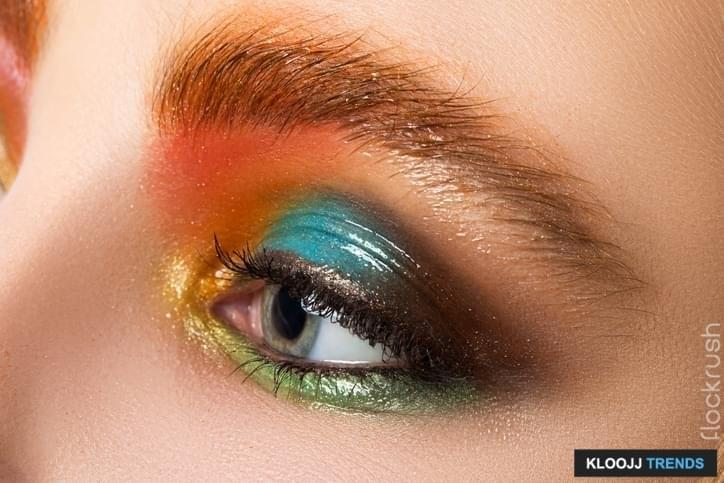 Close-up view of women eye with beautiful modern make-up. Multicolored somey eyes. Wet makeup.