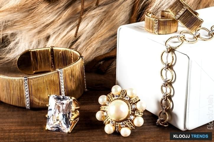 beautiful jewelry made of gold and precious stones rings, bracelets, earrings