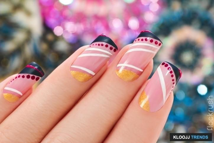 Elegant nail design on a rectangular shape nails covered with light pink lacquer with black, white,Golden figure.