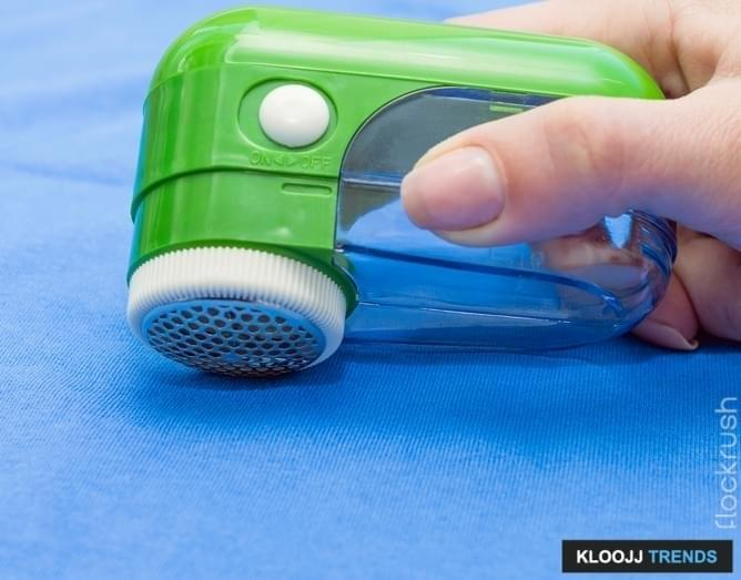 Electric lint remover. Selective focus.