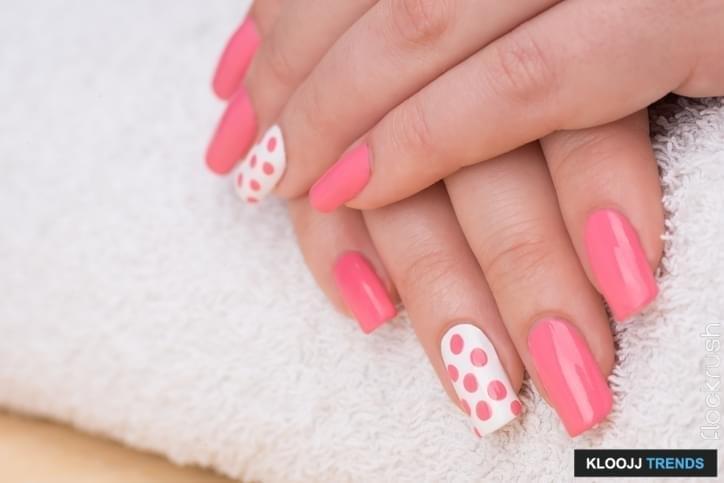 Beauty treatment photo of nice manicured woman fingernails. Very nice feminine nail art with nice pink and white nail polish.