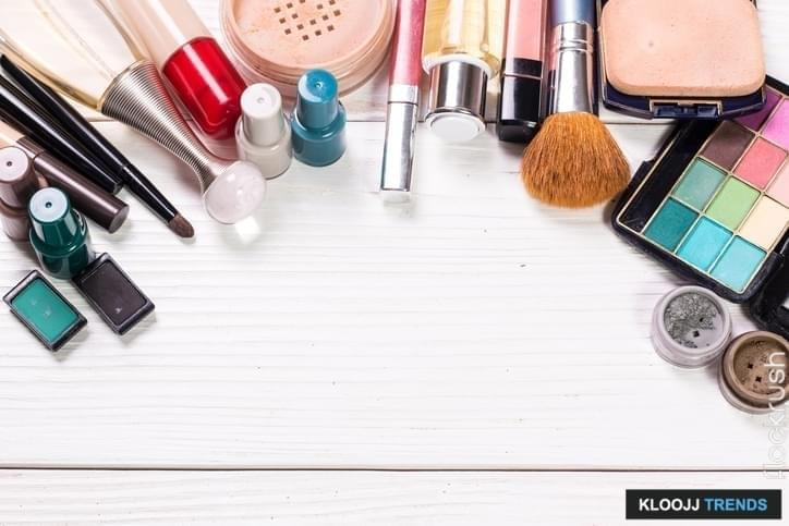 Various makeup products on wooden background with copyspace