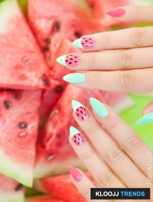 Hands close up of young woman with watermelon manicure and fruit, summer manicure nail art and food concept