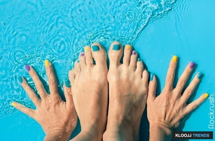 Colorful nails of hands and feet in the water