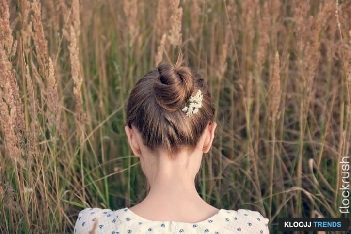 Back view of young woman with hair bun.