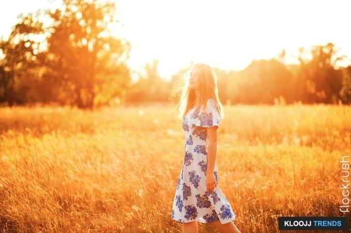 Beautiful young girl walking in flower park sunset background Healthy Lifestyle Soft focus