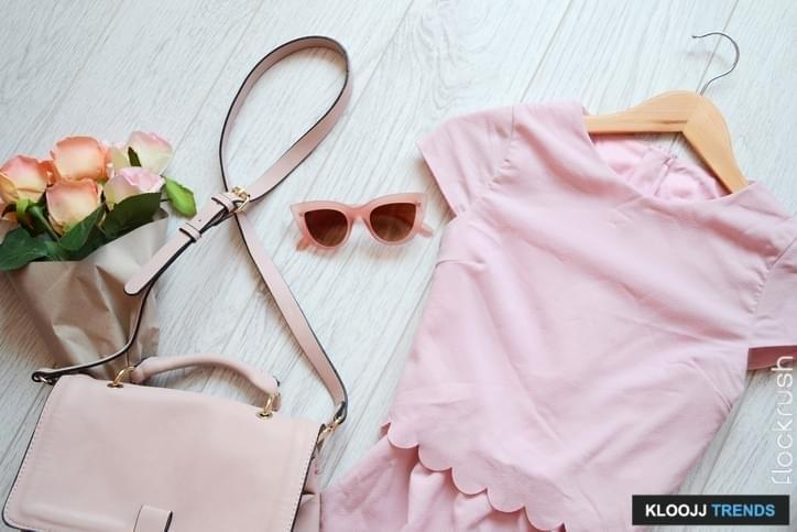Fashionable concept, pink style. Dress, bag and glasses. View from above