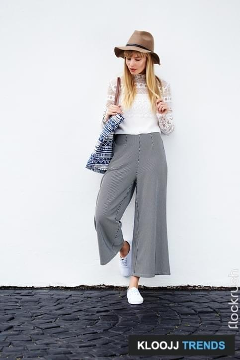 Posing young model in culottes and lace top