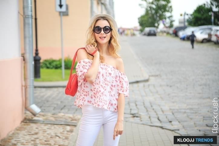 Smiling Fashion Woman in the Old Town Street. Happy Trendy Girl in Summer. Toned Photo with Copy Space.