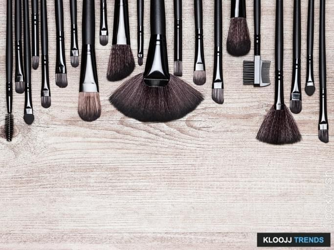 Set of various natural bristle makeup brushes: for applying foundation, powder, blush, eyeshadow, eyebrow brushes and others. Professional tools of make-up artist on shabby wooden surface. Copy space