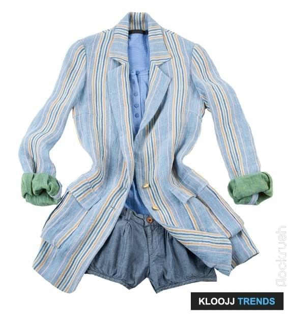 Fashion composition with oversized jacket, denim shorts, and blue t-shirt, isolated on white background.